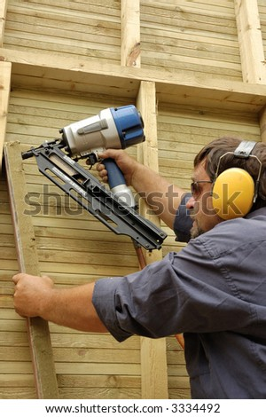 construction worker, carpenter in time of work - stock photo