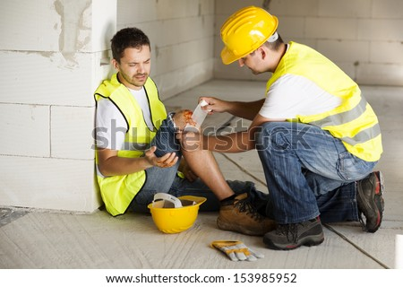 Construction worker has an accident while working on new house - stock photo