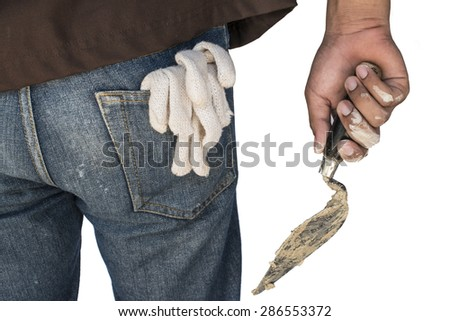 Construction worker hold Trowel and gloves in pocket. isolated. - stock photo