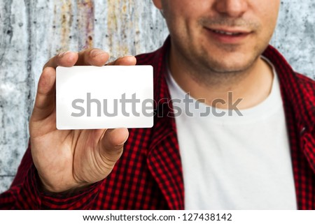 Construction worker holding a blank business card, business introduction concept.