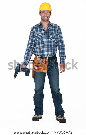 Construction worker holding a drill. - stock photo