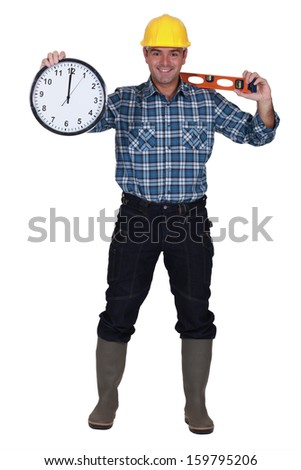 Construction worker holding clock - stock photo