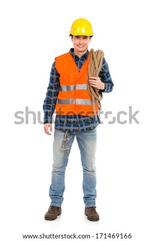Construction worker holds a rope. Full length studio shot isolated on white.