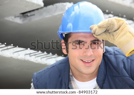 Construction worker in a hardhat - stock photo