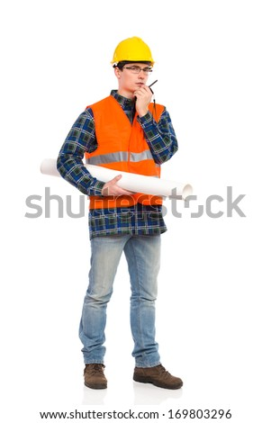 Construction worker in glasses holds paper roll and using walkie-talkie. Full length studio shot isolated on white. - stock photo