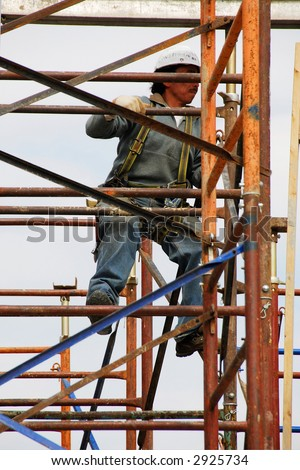 construction worker in scaffold - stock photo