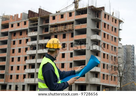 construction worker in uniform at work - stock photo