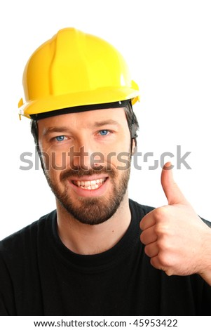 Construction worker in yellow hard hat. Happy caucasian male in his 20s. Young man portrait with thumbs up. - stock photo