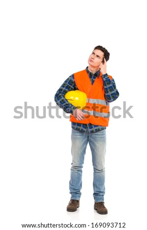 Construction worker in yellow helmet and orange waistcoat.  Full length studio shot isolated on white. - stock photo