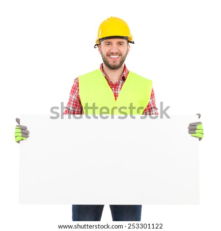 Construction worker in yellow helmet and reflective waistcoat holding white placard. Three quarter length studio shot isolated on white. - stock photo