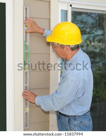 Construction worker installing new windows - stock photo