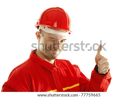 Construction worker is smiling and gesturing thumb up - stock photo