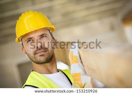 Construction worker is working on new house - stock photo