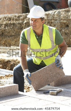 Construction Worker Laying Blockwork - stock photo