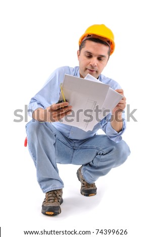 Construction worker looking at plans over white background - a series of MANUAL WORKER images. - stock photo