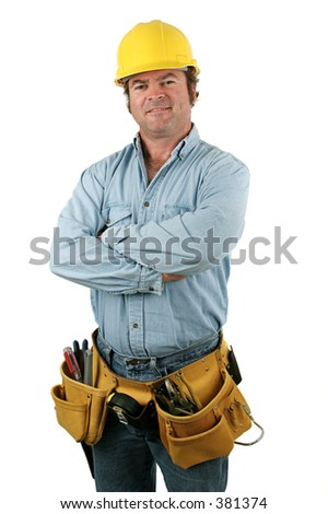 Construction worker looking friendly. Isolated. - stock photo