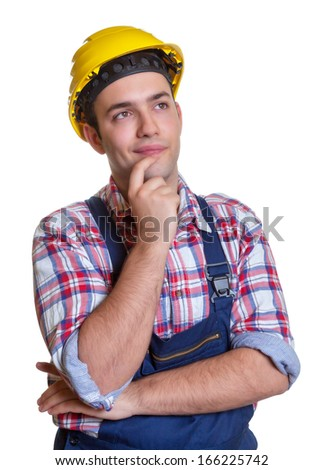 Construction worker making plans for the future - stock photo