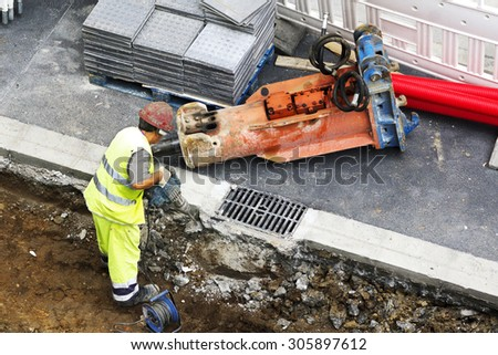 construction worker man  repairing the sewer and water  pipes in the street city  - stock photo