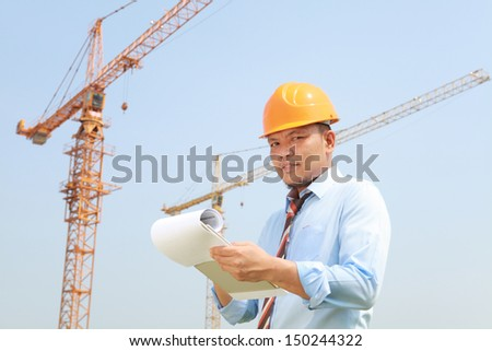 Construction worker manager activity with notepad on location site looking at you camera