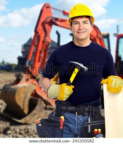 Construction worker near excavator. Home renovation background - stock photo