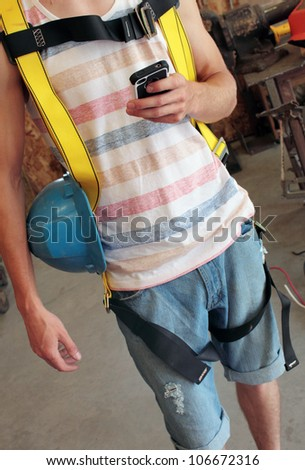 Construction Worker on his phone - stock photo