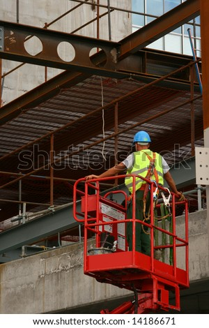 Construction worker on lift - stock photo