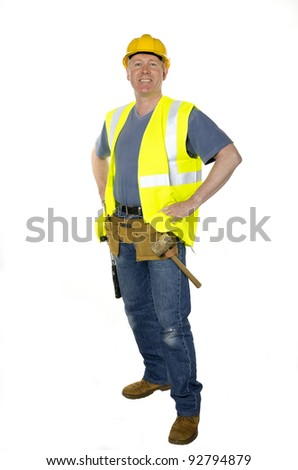Construction worker on white background stands with hands on hips smiling confidently