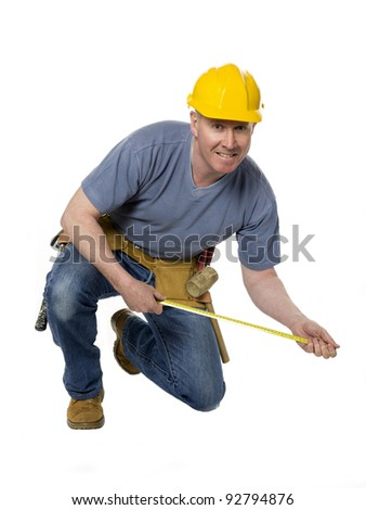 Construction worker on white background stretches to measure - stock photo