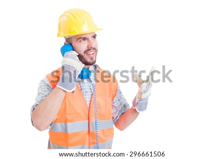 Construction worker or engineer talking on the phone isolated on white background - stock photo