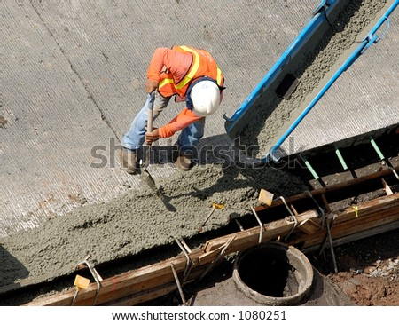 Construction worker pour cement for sidewalk in Honolulu Hawaii. - stock photo