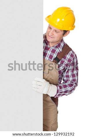 Construction worker presenting empty banner. Isolated on white background - stock photo