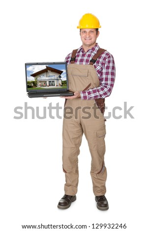 Construction worker presenting laptop. Isolated on white background - stock photo