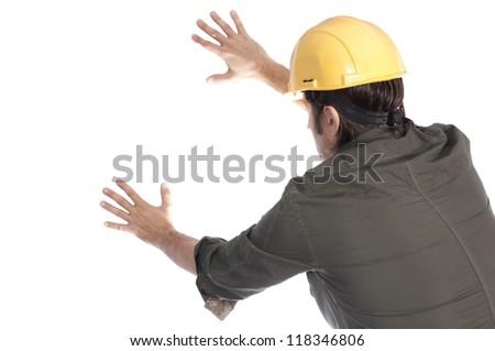 Construction worker pushing white background - stock photo