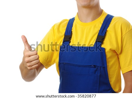 Construction worker showing thumb up sign, isolated over whit - stock photo