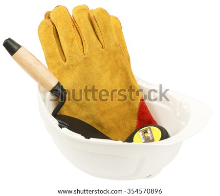 Construction worker supplies including white hard hat and gloves on isolated white background - stock photo