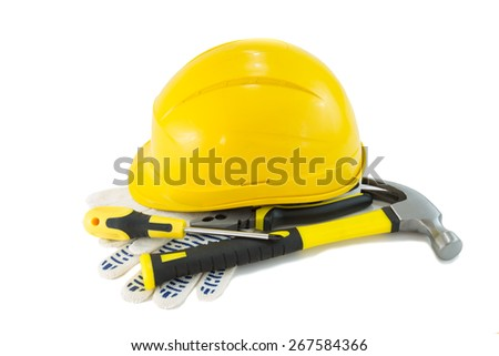 Construction worker tools set on a white background. Hammer, pillars, hardhat, protective gloves and a screwdriver. - stock photo