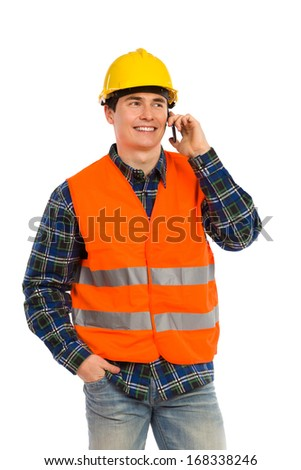 Construction worker using cell phone.Three quarter length studio shot isolated on white. - stock photo