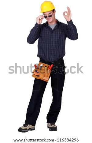 Construction worker wearing sunglasses - stock photo