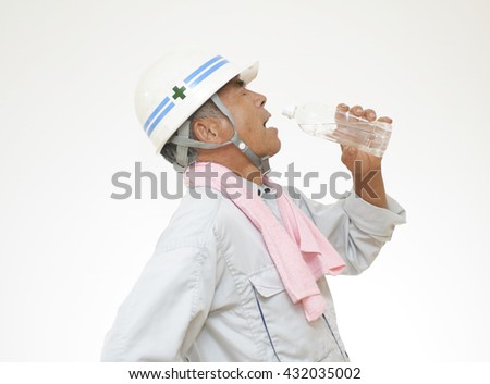 Construction Worker who drinks water
