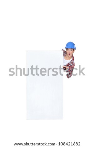 Construction worker with a blank board - stock photo