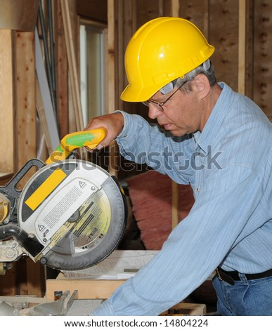 Construction worker with a saw - stock photo