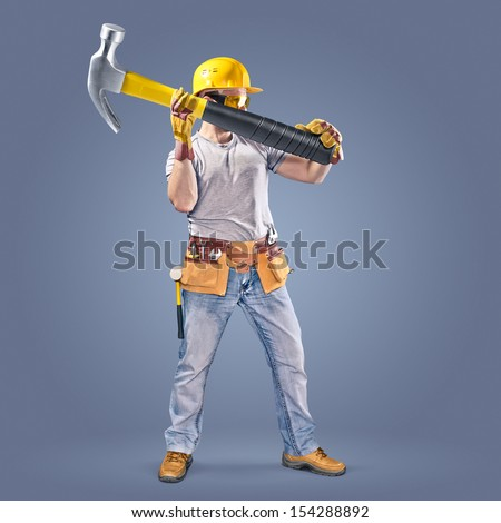 construction worker with a tool belt and a hammer - stock photo