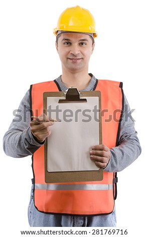 Construction worker with clipboard on hand over white background. - stock photo