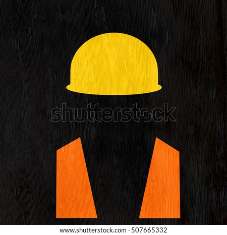 construction worker with hard hat on wood grain texture
