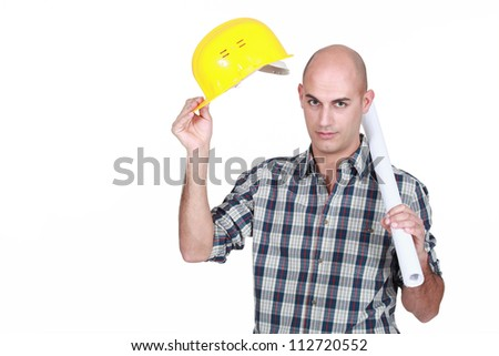 Construction worker with plans - stock photo
