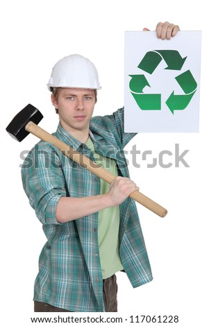 Construction worker with recycling poster