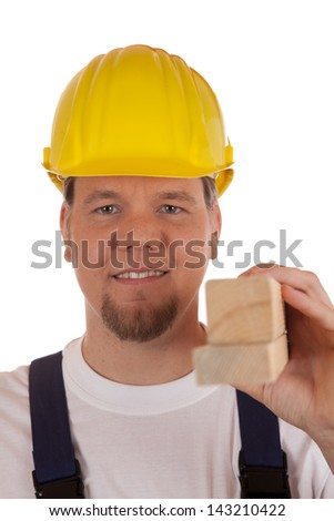 Construction worker with safety helmet holding wooden slats in his hand, isolated on white
