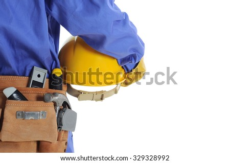 Construction worker with tool bag & helmet - stock photo