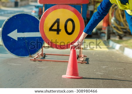construction worker with traffic cone traffic cone - stock photo