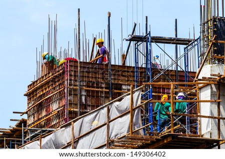 Construction worker working on a construction site. - stock photo